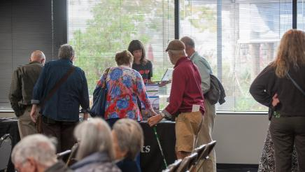 Constituents viewing materials at the climate change discussion